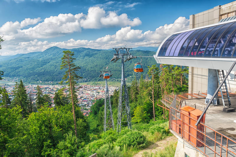 Cablaway with cable car arriving on top of mountain stock photos