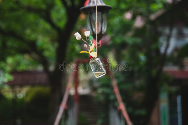 Cable bridge in the mountains with tied colored ribbons and other tinsel stock photography