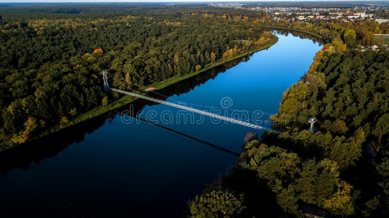 Cable bridge over the river view from the top. Cable bridge over the river view from the top royalty free stock photography