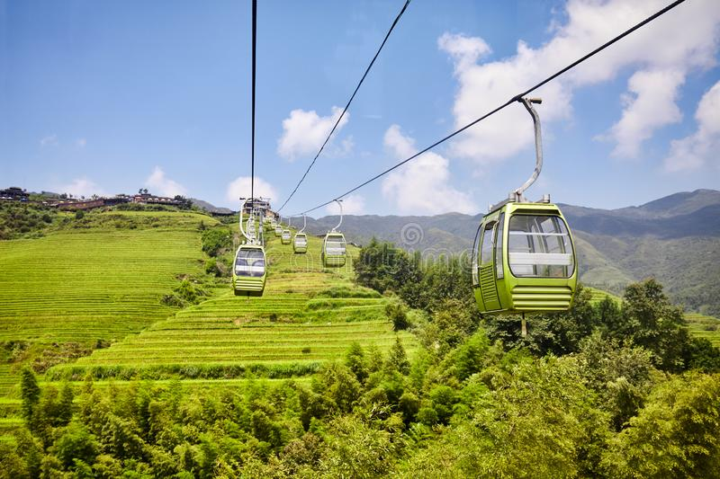 Cable car above the Longji Rice Terraces, China stock photography