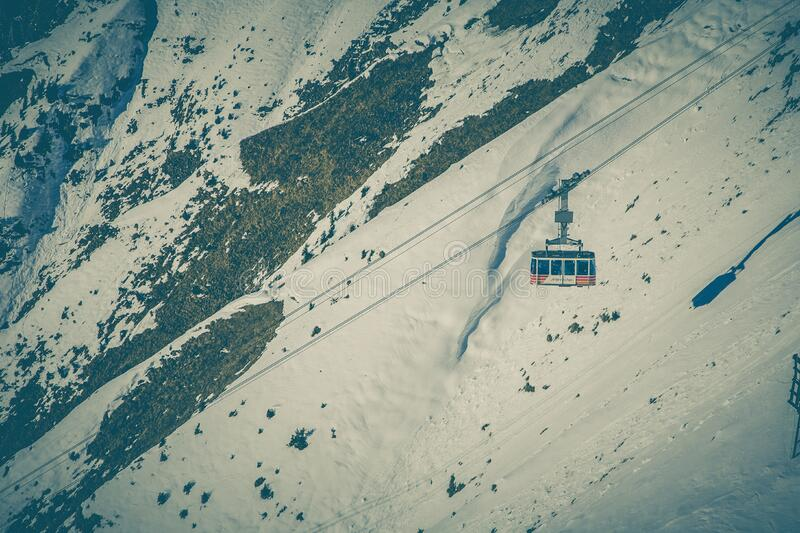 Cable Car Above Snow Covered Mountain stock images