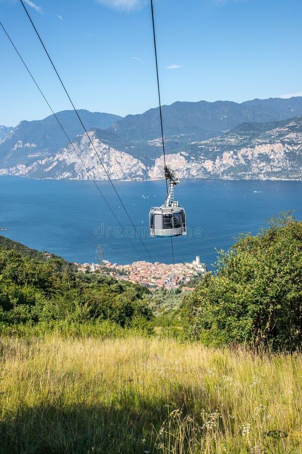 Cable car on a beautiful summer day, landscape monte baldo, lago di garda. Mountain, ropeway, cabin, outdoors, hiking, sightseeing, cable, car, lago, di, garda stock photo