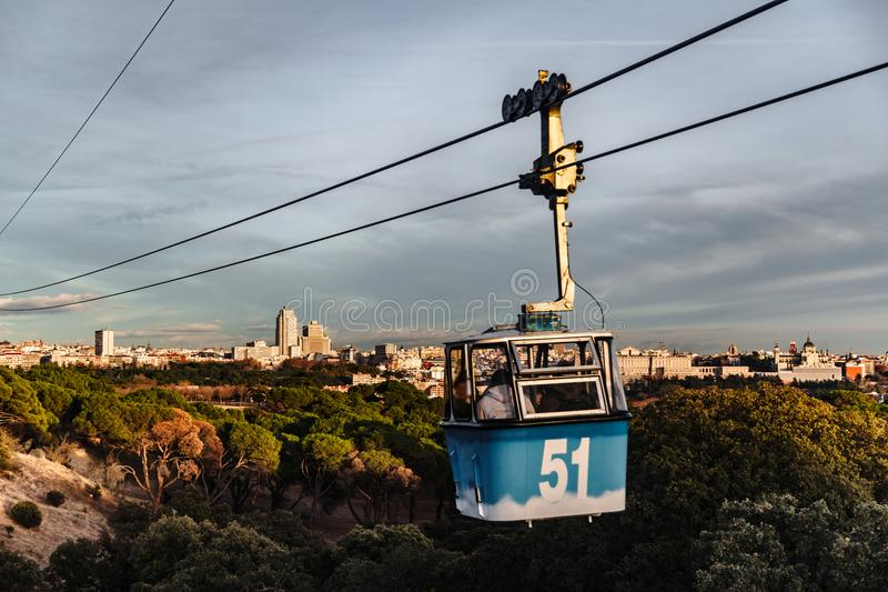 Cable car and cabin rides over park in Madrid royalty free stock images
