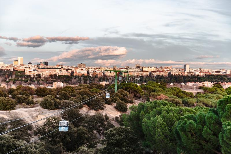 Cable car and cabin over park in Madrid royalty free stock photo