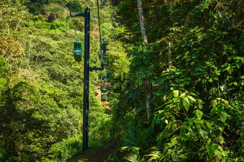 Cable car cabins riding through the tropical rainforest near Jaco in Costa Rica royalty free stock images