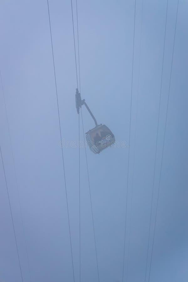 Cable car and fog stock photos