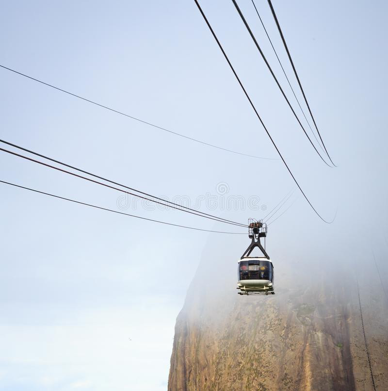 Cable Car emerges from fog in Rio de Janeiro stock image