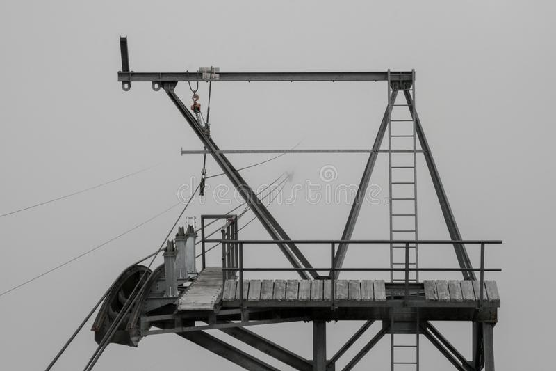 Cable car in the fog. Gondola in the swiss alps through foggy and cloudy sky royalty free stock photo