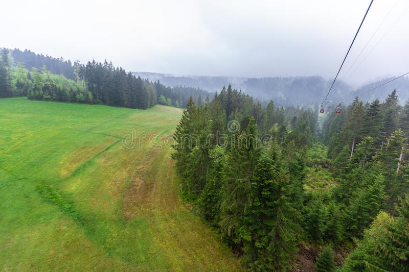 Cable car in the fog. Alps Mountains stock photography