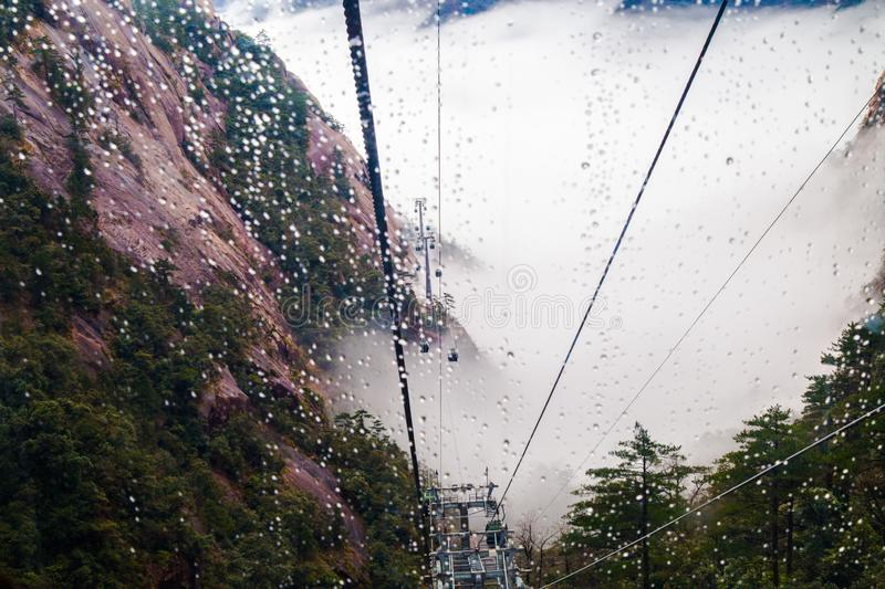 Cable car in rain and fog royalty free stock image