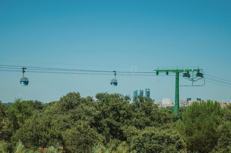 Cable car gondola and big supporting towers at the Teleferico Park of Madrid royalty free stock image