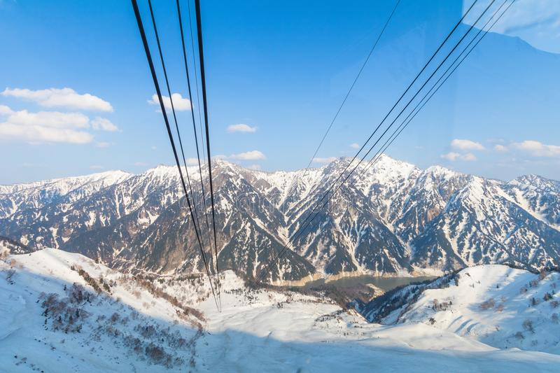 Cable car line going to Tateyama Kurobe Alpine Route on the snow royalty free stock image