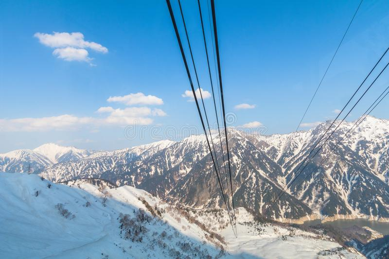 Cable car line going to Tateyama Kurobe Alpine Route on the snow royalty free stock photo