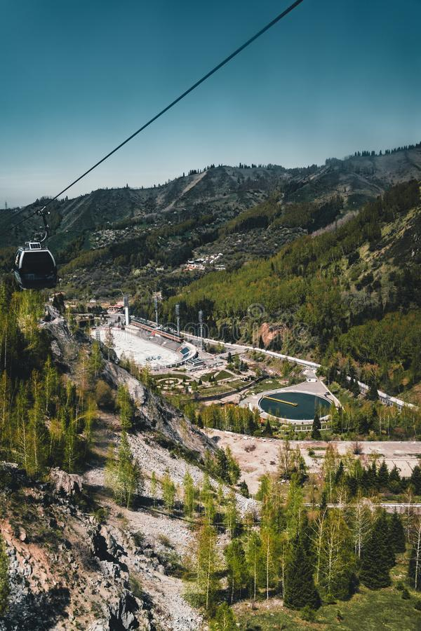 Cable car with Medeo stadium in Almaty, Kazakhstan. Medeo stadium is the highest located in the world - 1691 m. above. Aerial view of the Medeo stadium in Almaty stock photo