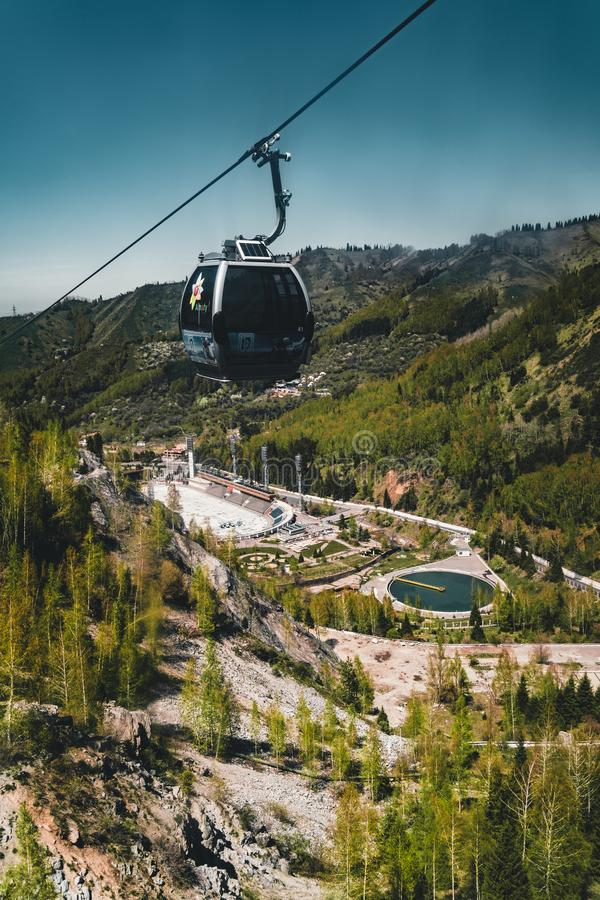 Cable car with Medeo stadium in Almaty, Kazakhstan. Medeo stadium is the highest located in the world - 1691 m. above. Aerial view of the Medeo stadium in Almaty royalty free stock images
