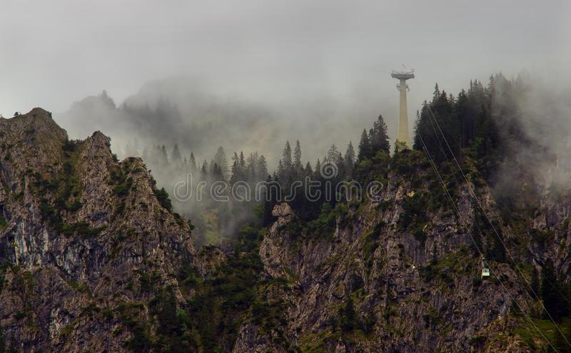 Cable car in the mountains and fog. royalty free stock photo