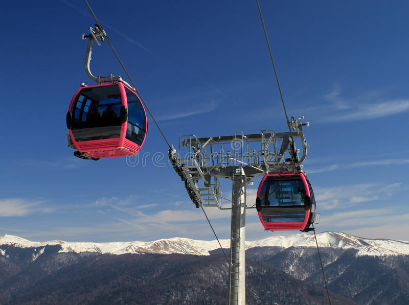 Cable car in the mountains stock photos