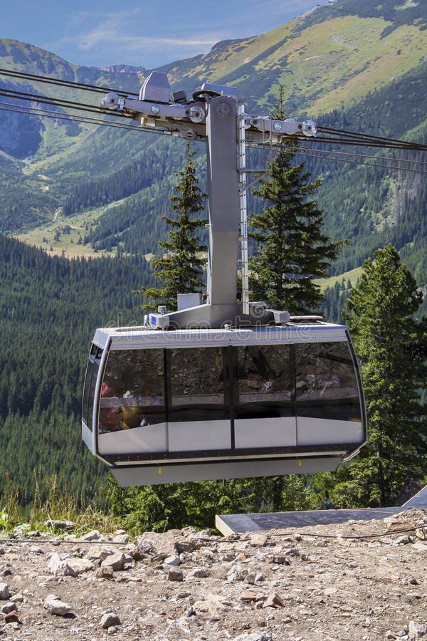 Cable car in the mountains. Wagon with tourists royalty free stock photography
