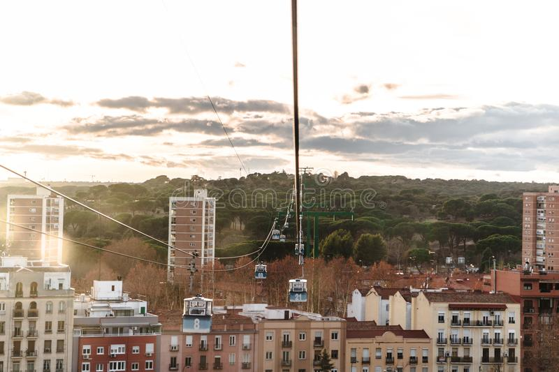 Cable car over park in Madrid, Spain royalty free stock image