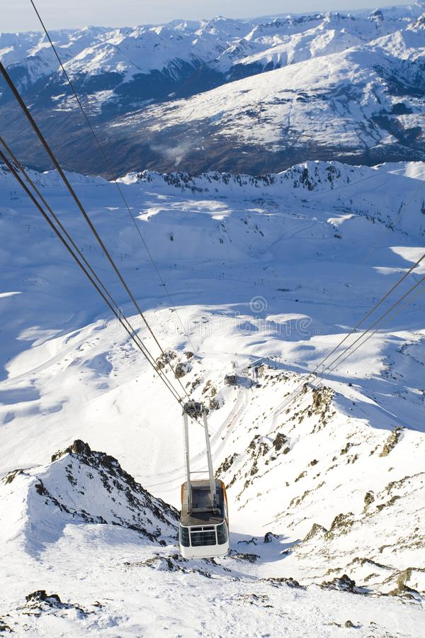 Cable car in the mountains. Cable car at the peaks of mountains royalty free stock image