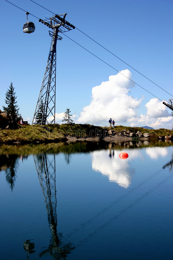 Download Cable Car Reflected In Mountaintop Lake Stock Image - Image: 250149