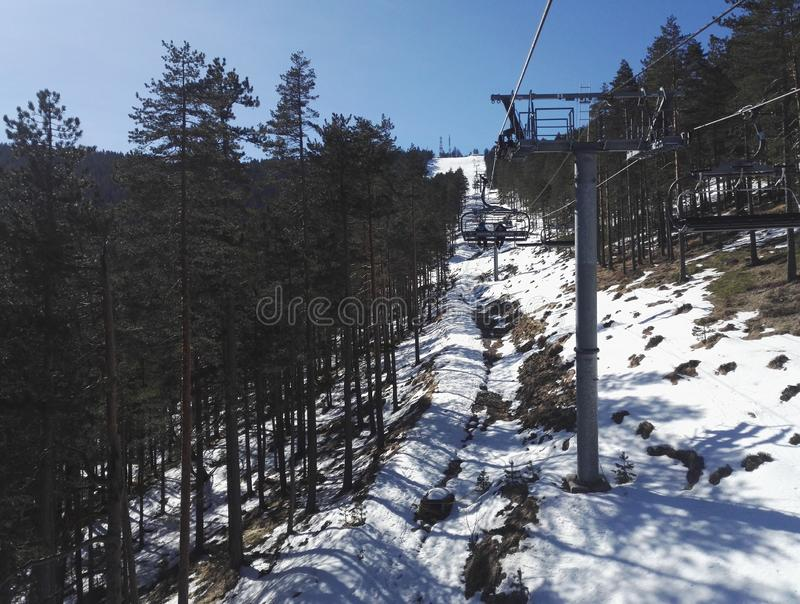 Cable car road covered in snow, going through mountain royalty free stock photos