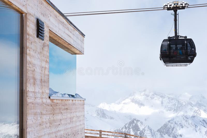 Cable car at a ski resort. The movement of the black cabin. Holidays in the Alps stock image