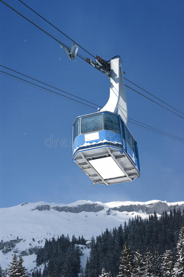 Download Cable Car With Specs Of Snow Stock Photo - Image: 13404848