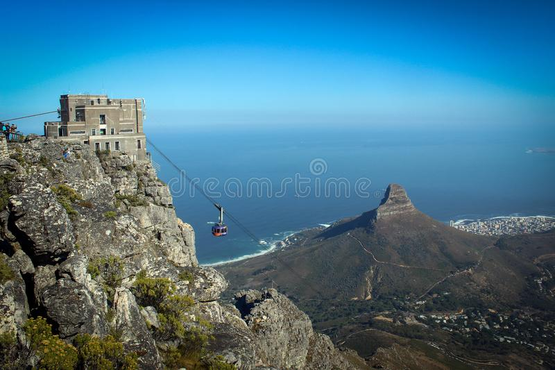 Cable car station view on top of Table Mount, Cape Town. Cable car station view on top of Table Mount with Lion`s Head panorama, Cape Town, South Africa stock photo