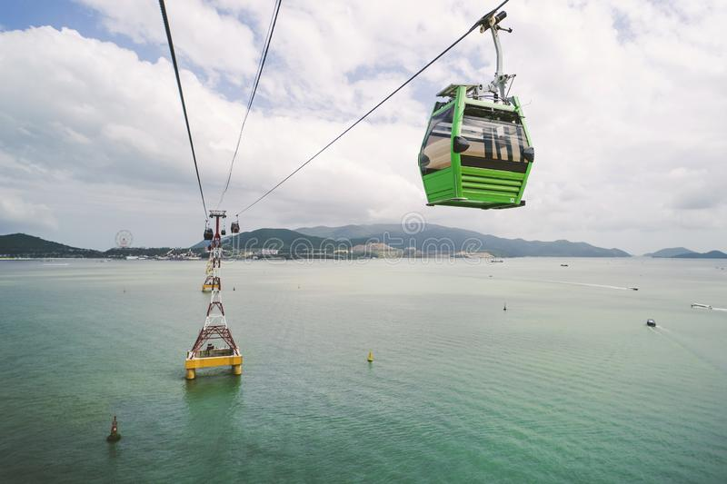 Cable car to amusement park in morning sunshine to attract tourists to the weekend relaxing in Nha Trang, Vietnam. Cable car to amusement park in the morning stock image