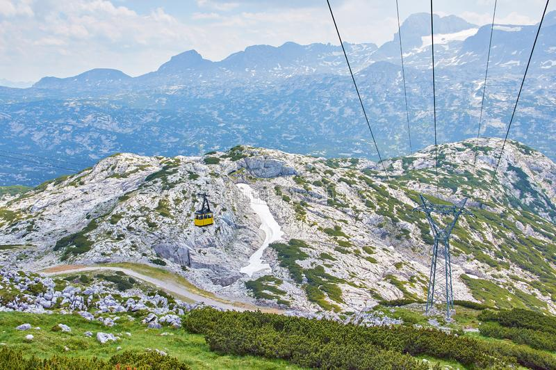 Cable Car to Mountain Dachstein in Salzkammergut region. Austrian Alps. Neutral colors. Beautiful Mountains. Landscape with blue sky stock images