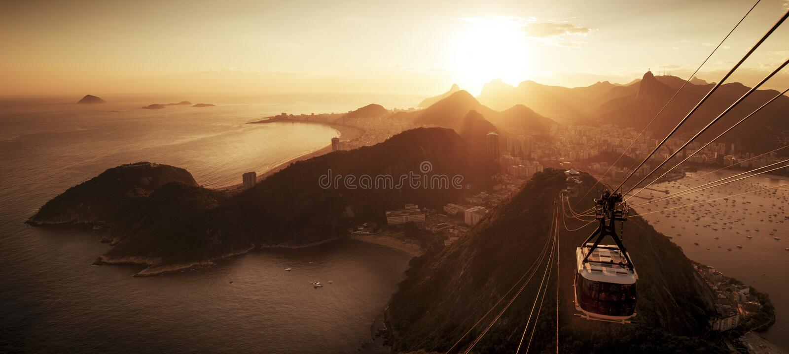 Cable car to sugarloaf mountain and panorama of Rio de Janeiro stock image