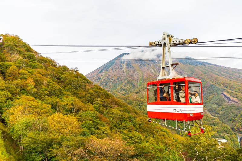 Cable car and tourist at Akechidaira plateau in autumn at Akechidaira Ropeway Station, Nikko, Japan. stock photography