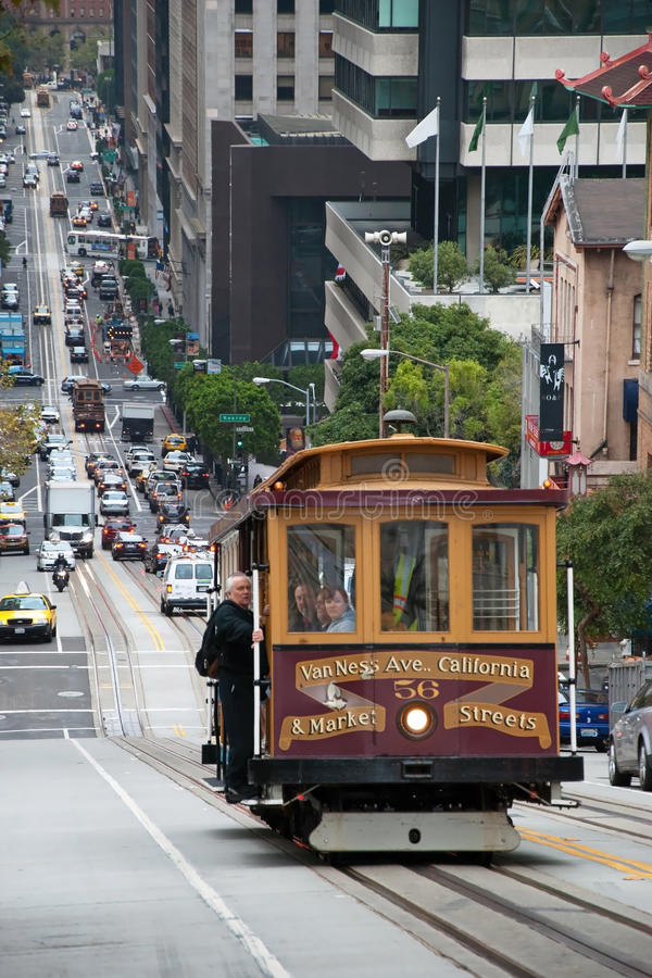 Download Cable Car Tram In San Francisco Climbing Up The Street Editorial Image - Image of hill, commuter: 32324985