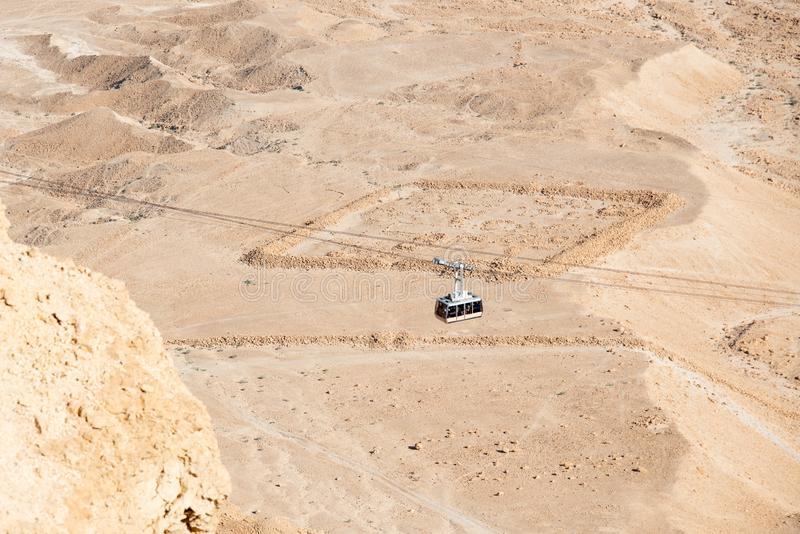 The cable car transporting passengers in ancient fortress Masada stock photo