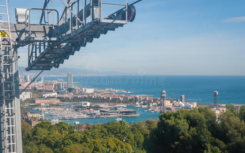 Cable car view of Barcelona city and coastline of Spain. Beautiful Blue commerce in the ports of Spain in Barcelona. Balearic sea & coastline of modern royalty free stock photography