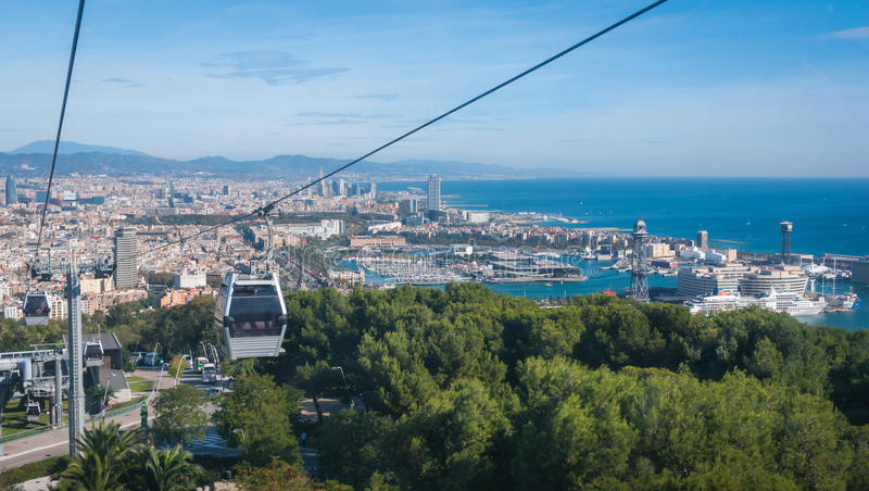 Cable car view of Barcelona city and coastline of Spain. Beautiful Blue commerce in the ports of Spain in Barcelona. Balearic sea & coastline of modern royalty free stock image