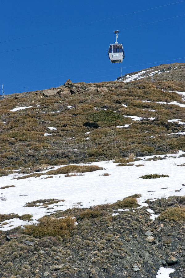 Cable car on way up mountain of ski resort royalty free stock images