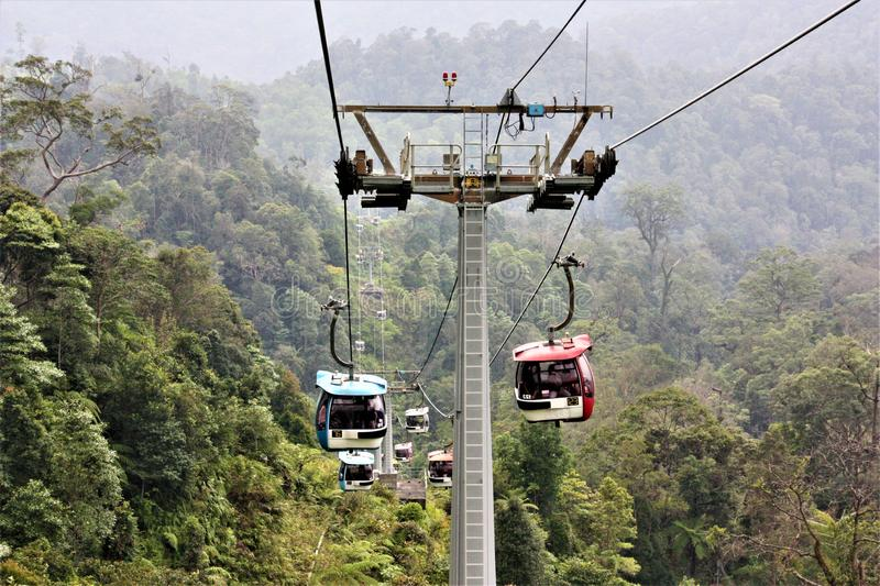 Cable cars to and fro Genting Highland Malaysia Pahang. Forest green misty peaceful royalty free stock images