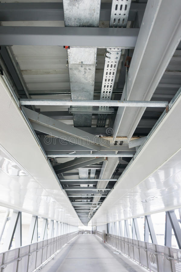 Cable Containment Work. The cable tray and piping construction at site stock photography
