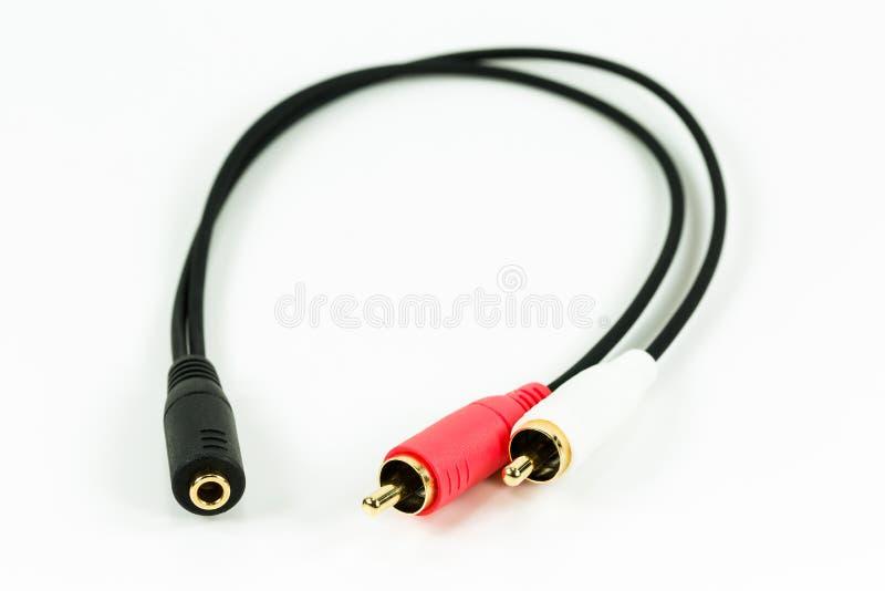 cable de audio de la cincha del Y-cable con los conectores de oro aislados en whi imagenes de archivo