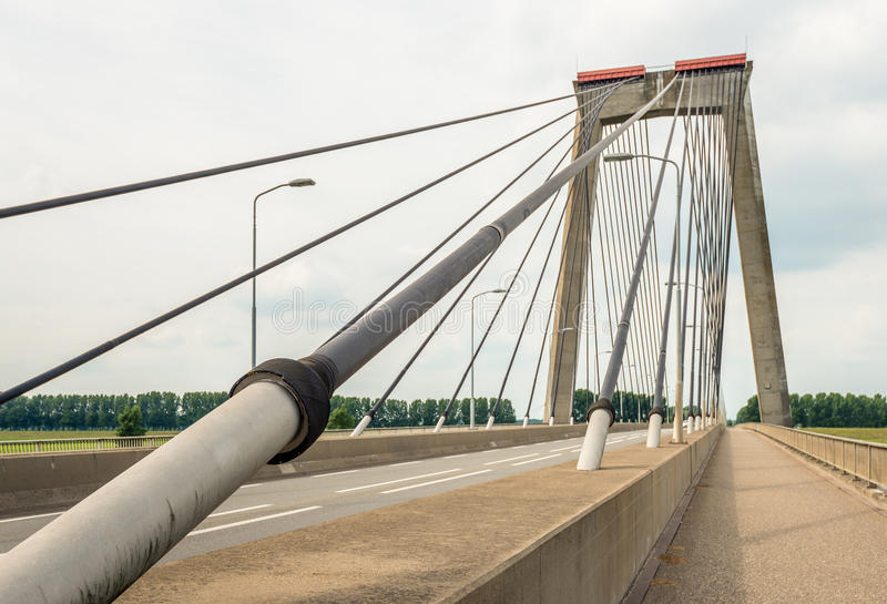 Cable of a Dutch cable-stayed bridge from close royalty free stock photos