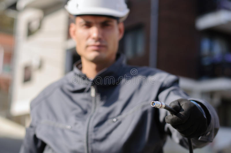 Cable guy holding optical cable royalty free stock images