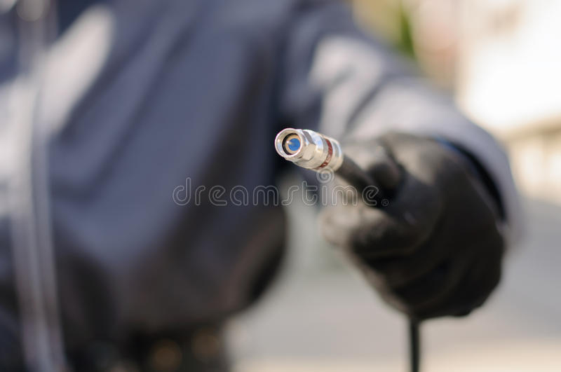 Cable guy holding optical cable royalty free stock photos