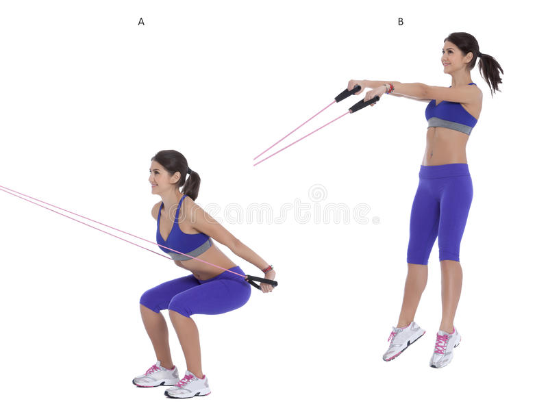 Cable jumping squat. Holding onto the straps, squat all of the way down, getting your as close to the floor as possible. (A) When you reach the bottom of the royalty free stock image