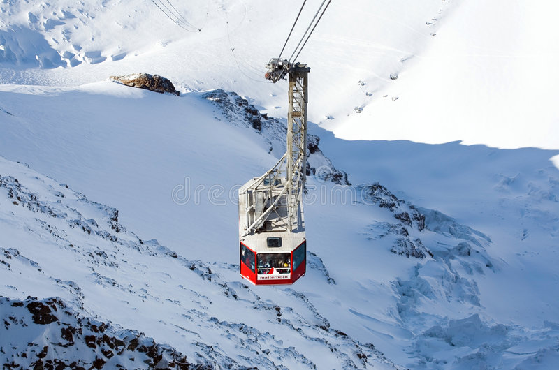 Cable lift on snowy mountain. Scenic view of cable car lift to Matterhorn Glacier Paradise in Alps mountains royalty free stock photos