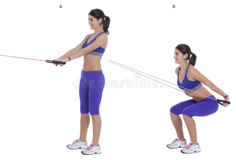 Cable squat to row stock photos