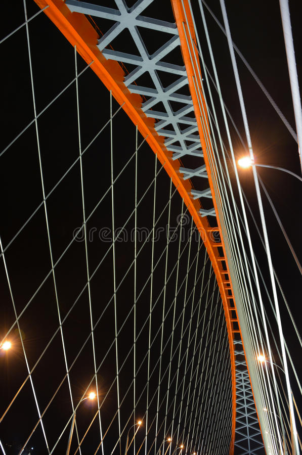 Cable-stayed through arch bridge (Bugrinsky Bridge) over river Ob at night, in Novosibirsk, Siberia, Russia. Constructions of the red cable-stayed through arch royalty free stock image