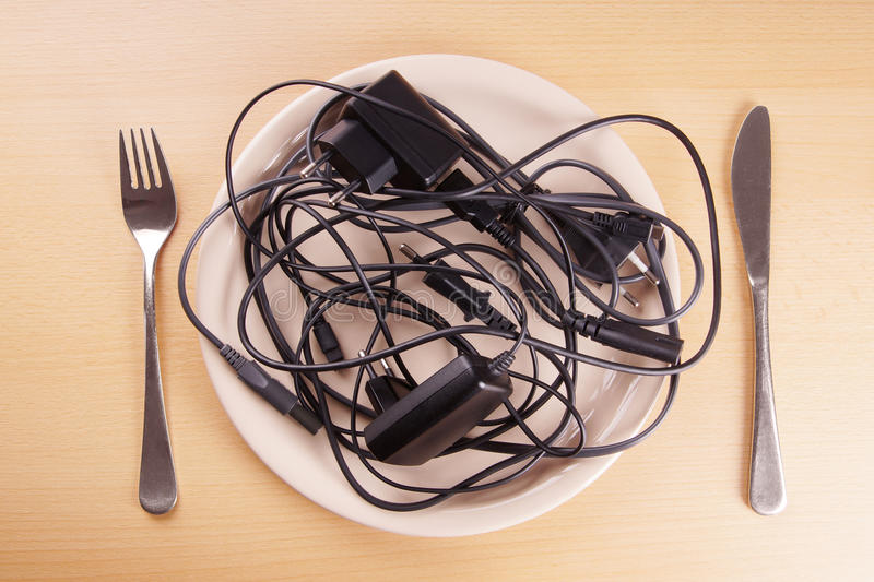 Cable tangle on a plate stock photo