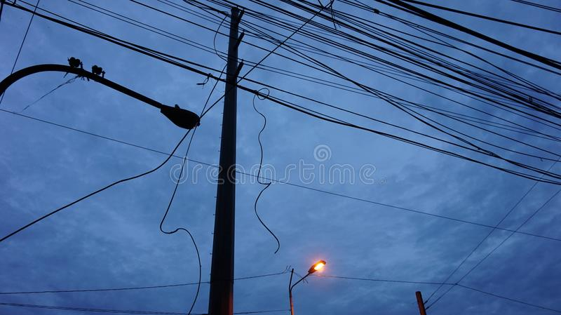 Cable Wires Crossing in the Sky stock photo
